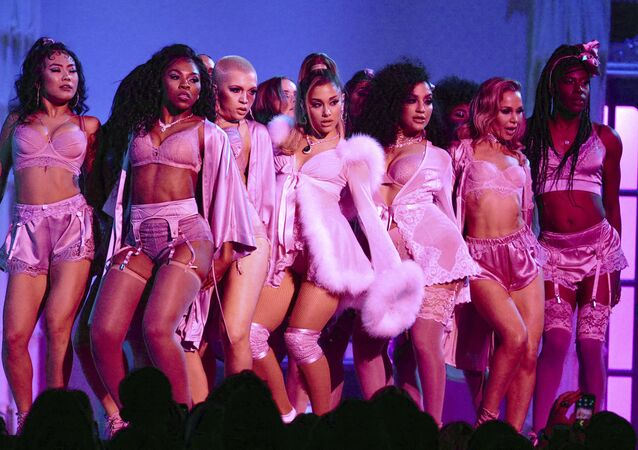 Ariana Grande, center, performs a medley at the 62nd annual Grammy Awards on Sunday, Jan. 26, 2020, in Los Angeles.