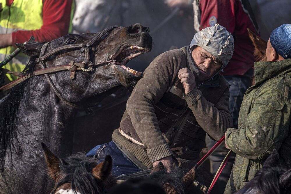 Horsemen take part in a national game, Alaman Ulak, in the Kara-Suyisky district of Kyrgyzstan