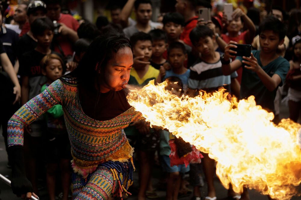 A performer blows fire during Chinese Lunar New Year celebrations in Chinatown, Binondo, Manila, Philippines, January 25, 2020.