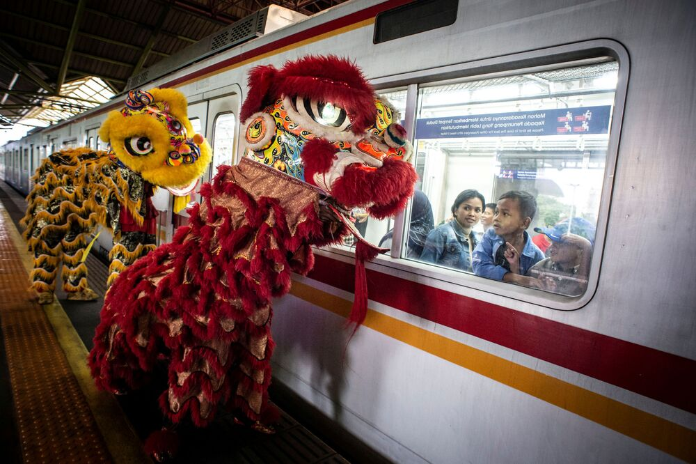 Passengers look from the window of a train as Lion-dances perform at a platform of Gambir station during Chinese Lunar New Year of the Rat celebrations in Jakarta, Indonesia, January 25, 2020 in this photo taken by Antara Foto.