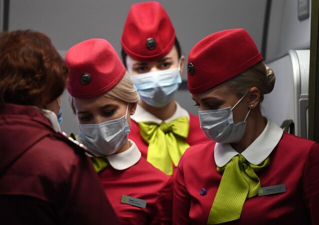 Flight attendants wearing face masks on board a S7 Airlines flight which arrived from Beijing to Novosibirsk