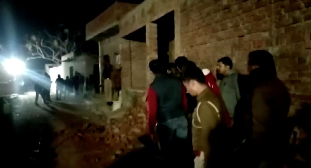 Residents and police personnel stand outside the building where a man has held hostages in Farrukhabad, Uttar Pradesh, India January 30, 2020 0 in this still image taken from video