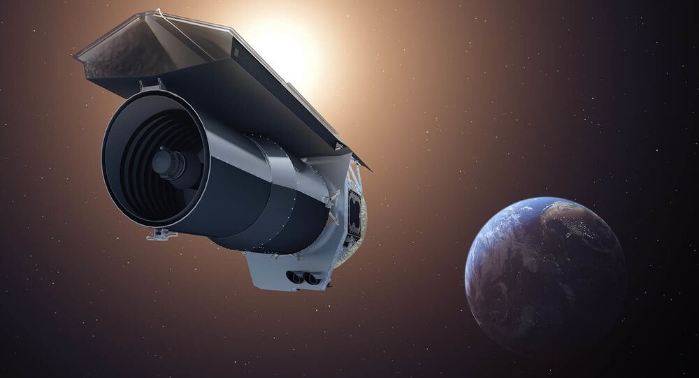 The artist's concept shows NASA's Spitzer Space Telescope