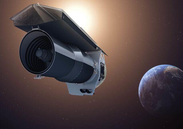 The artist's concept shows NASA's Spitzer Space Telescope