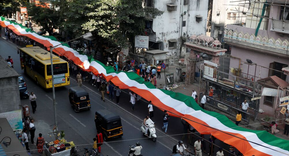 People hold an Indian national flag during a unity rally in Mumbai, India, January 24, 2020