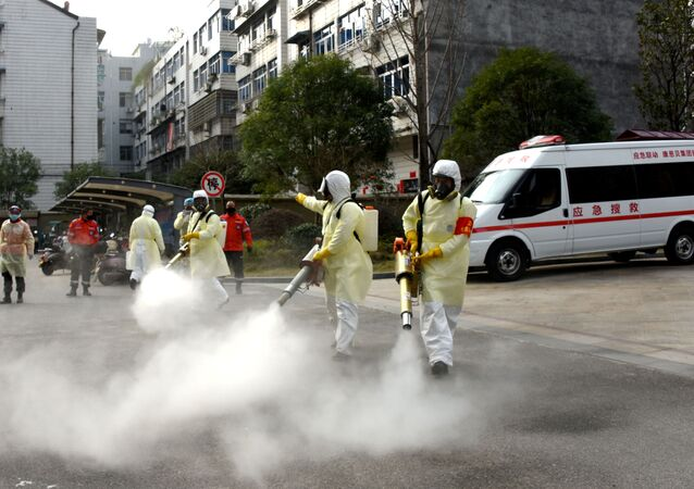 Volunteers in protective suits disinfect a residential compound, as the country is hit by the outbreak of a new coronavirus, in Taizhou, Zhejiang province, China January 30, 2020