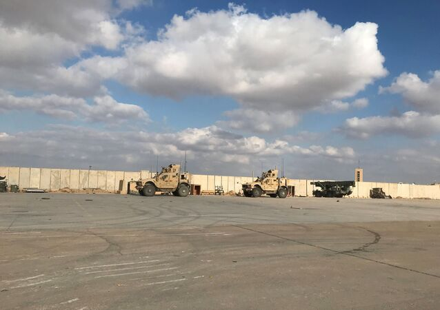Military vehicles of U.S. soldiers are seen at Ain al-Asad air base in Anbar province, Iraq