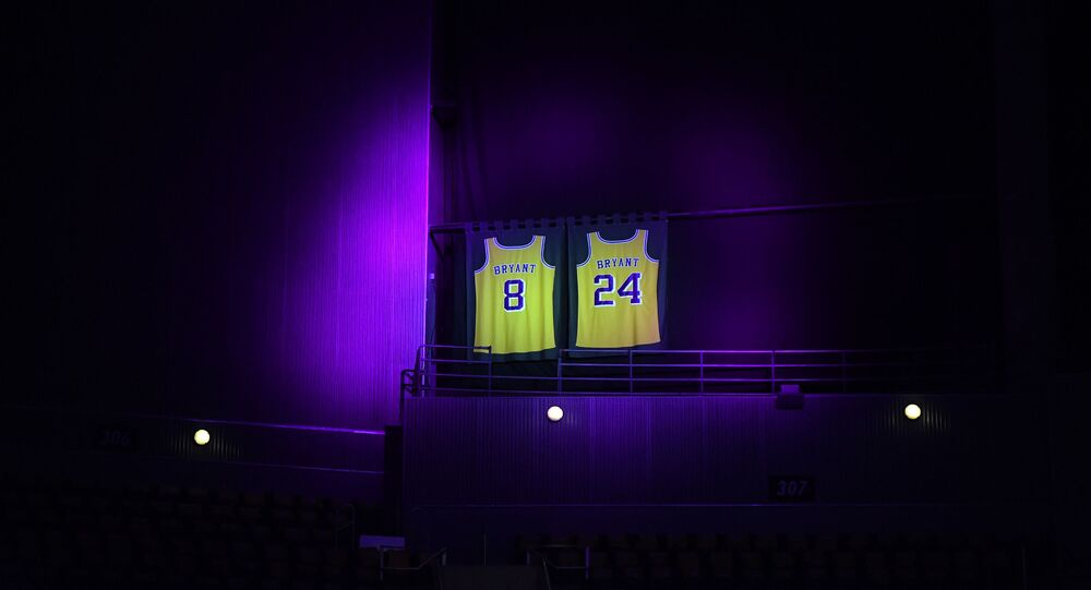 The jerseys of Los Angeles Lakers Kobe Bryant are lit with a purple spotlight for the game against the Portland Trail Blazers at Staples Center