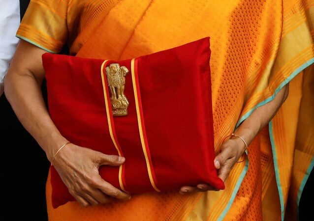 India's Finance Minister Nirmala Sitharaman holds budget papers during a photo opportunity as she leaves her office to present the federal budget in the parliament in New Delhi, India, February 1, 2020.