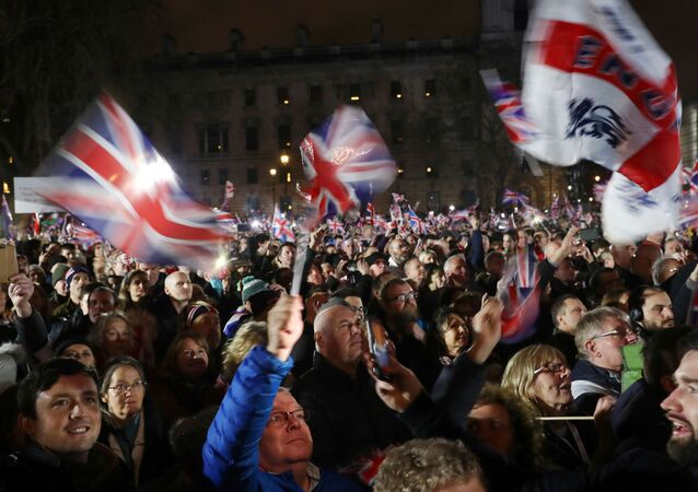People celebrate in Parliament Square on Brexit day in London, Britain January 31, 2020.
