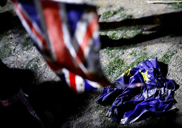 The flag of the European Union is pictured on the ground covered with a mud on Brexit day in London, Britain January 31, 2020.