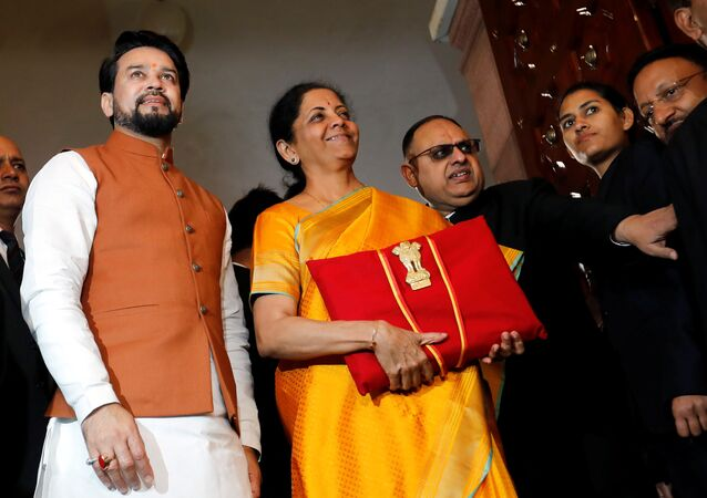 India's Finance Minister Nirmala Sitharaman is flanked by junior Finance Minister Anurag Thakur as she arrives to present the budget in Parliament in New Delhi, India, February 1, 2020.