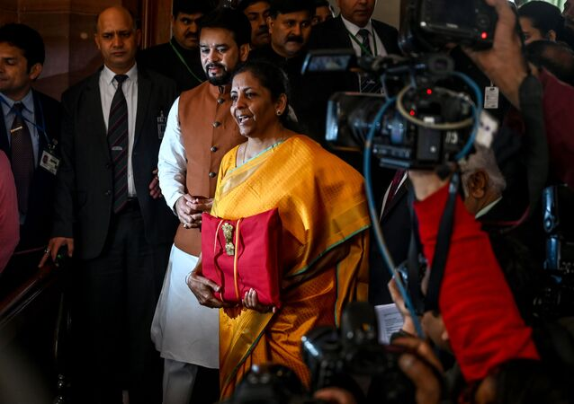 India Finance Minister Nirmala Sitharaman (C) arrives at the Parliament to the 2020-21 union Budget, in New Delhi on February 1, 2020.