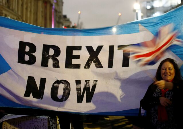 A woman waves a British flag on Brexit day in London, Britain January 31, 2020.