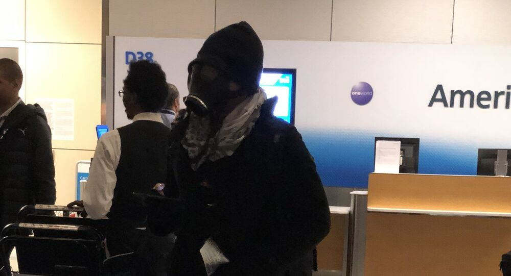 Passengers aboard an American Airlines flight waiting to take off from Dallas Fort Worth International Airport on Thursday were alarmed when they saw a man board wearing a gas mask