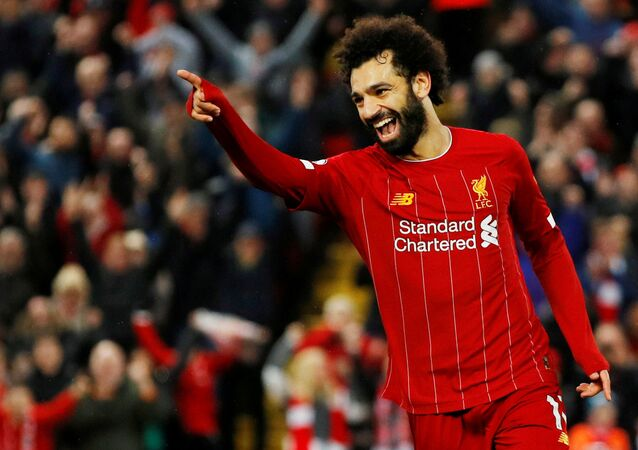 Soccer Football - Premier League - Liverpool v Southampton - Anfield, Liverpool, Britain - February 1, 2020  Liverpool's Mohamed Salah celebrates scoring their fourth goal