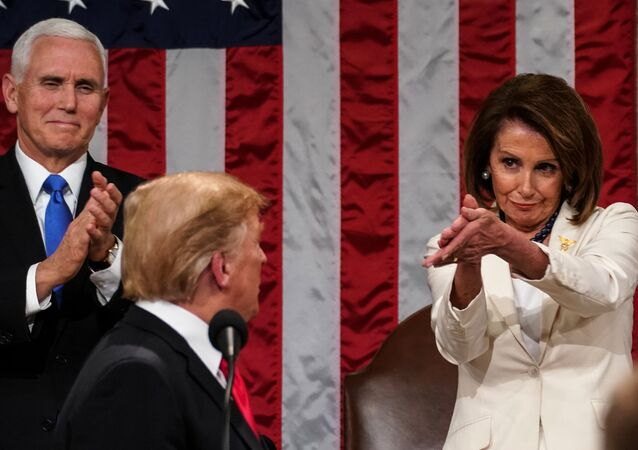 US President Donald Trump arrives to deliver the State of the Union address, alongside Speaker of the House Nancy Pelosi and Vice President Mike Pence,at the US Capitol in Washington, DC, on February 5, 2019.