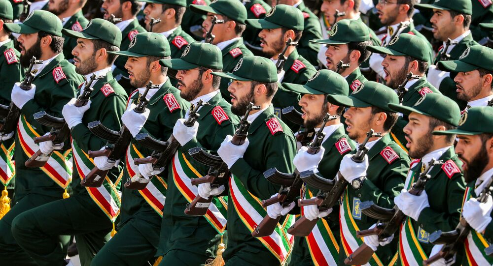 (FILES) In this file photo taken on September 22, 2018 shows members of Iran's Revolutionary Guards Corps (IRGC) marching during the annual military parade which markins the anniversary of the outbreak of the devastating 1980-1988 war with Saddam Hussein's Iraq, in the capital Tehran.