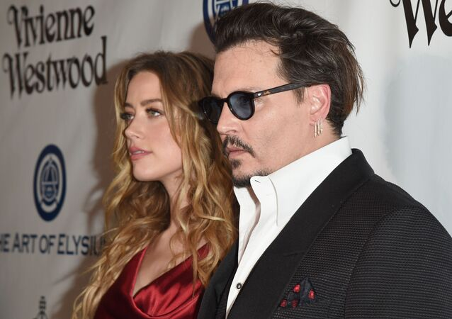 CULVER CITY, CA - JANUARY 09: Actors Amber Heard (L) and Johnny Depp attend The Art of Elysium 2016 HEAVEN Gala presented by Vivienne Westwood & Andreas Kronthaler at 3LABS on January 9, 2016 in Culver City, California.