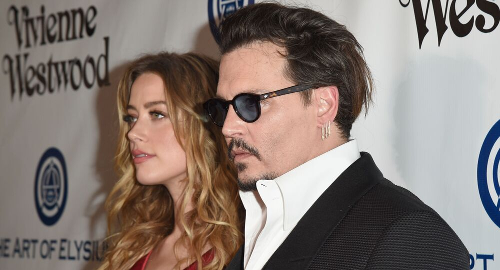 Amber Heard admits to hitting Johnny Depp in leaked audio clip