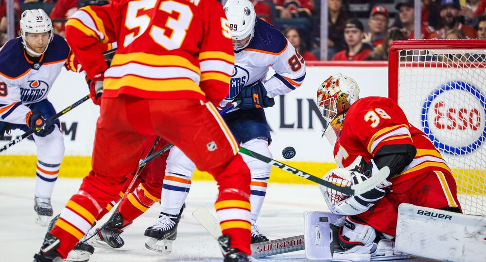 Calgary Flames Goaltender Cam Talbot Makes Save Against Edmonton Oilers During 2nd Period at Scotiabank Saddledome