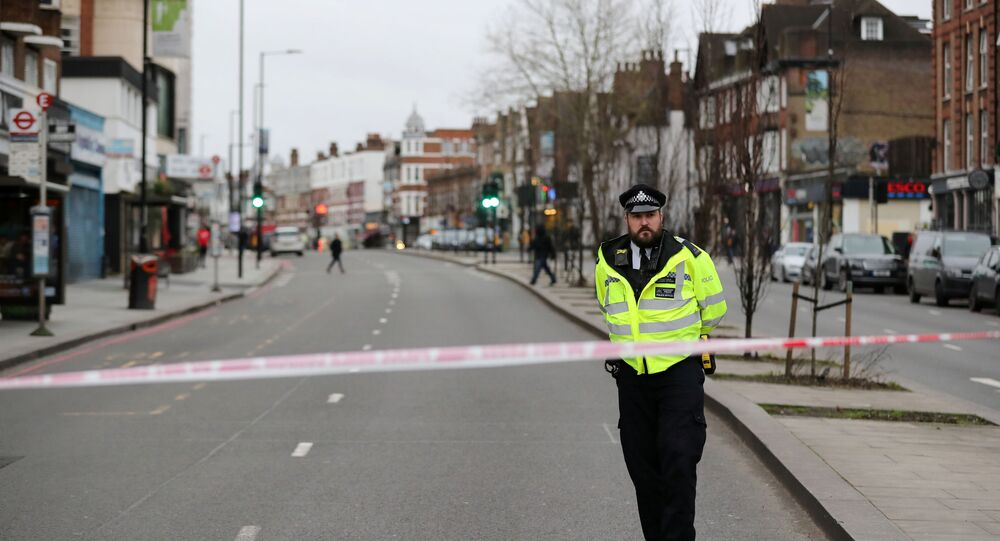 UK Police Officer Stands Next to Stabbing Incident Site in Streatham, South London