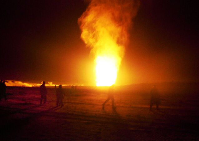Flames shoot into the air after a gas pipeline explosion in the Sinai peninsula, 240 miles (374 kilometers) southeast of Cairo, Egypt, Sunday, Feb. 5, 2012