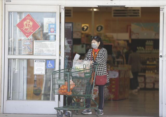 Customers wear protective masks as they shop at the 168 Market in Alhambra, Calif., Friday, Jan. 31, 2020. As China grapples with the growing coronavirus outbreak, Chinese people in the Los Angeles area, home to the third-largest Chinese immigrant population in the United States, are encountering a cultural disconnect as they brace for a possible spread of the virus in their adopted homeland.