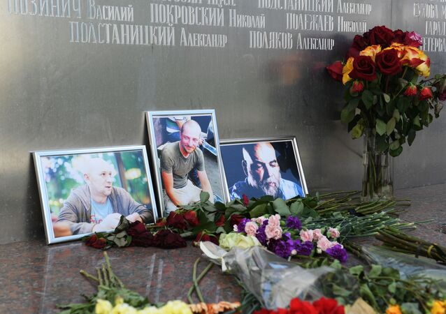 Flowers and Pictures of Russian Journalists Killed in 2018 in CAR