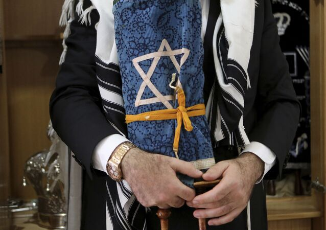 Rabbi holds a rare 200 year-old Torah