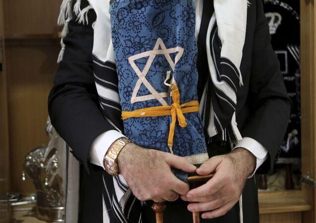 Rabbi holds a rare 200 year-old Torah