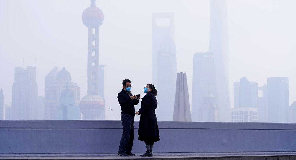 People Wearing Masks in Front of Financial District in Shanghai