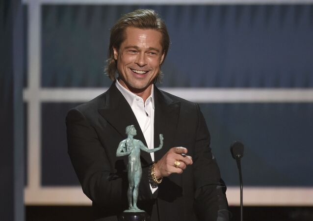 Brad Pitt accepts the award for outstanding performance by a male actor in a supporting role for Once Upon a Time in Hollywood