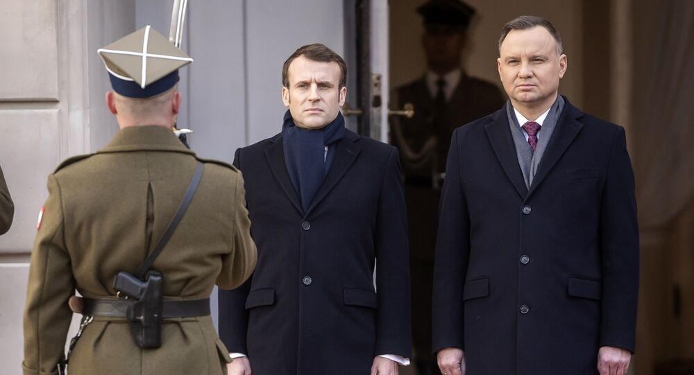 Polish President Andrzej Duda welcomes French President Emmanuel Macron