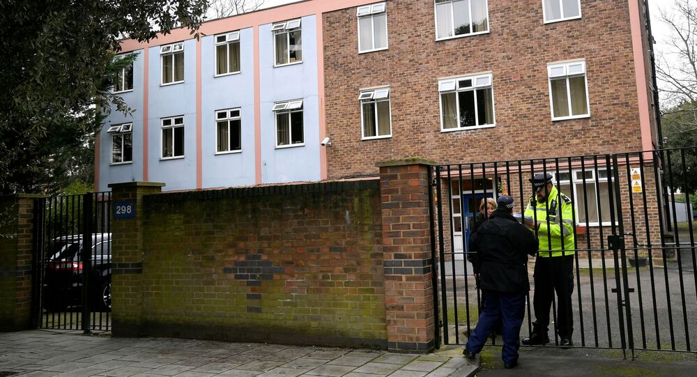 Police officers stand outside a premises being searched, in Streatham, south London, Britain, February 3, 2020. REUTERS
