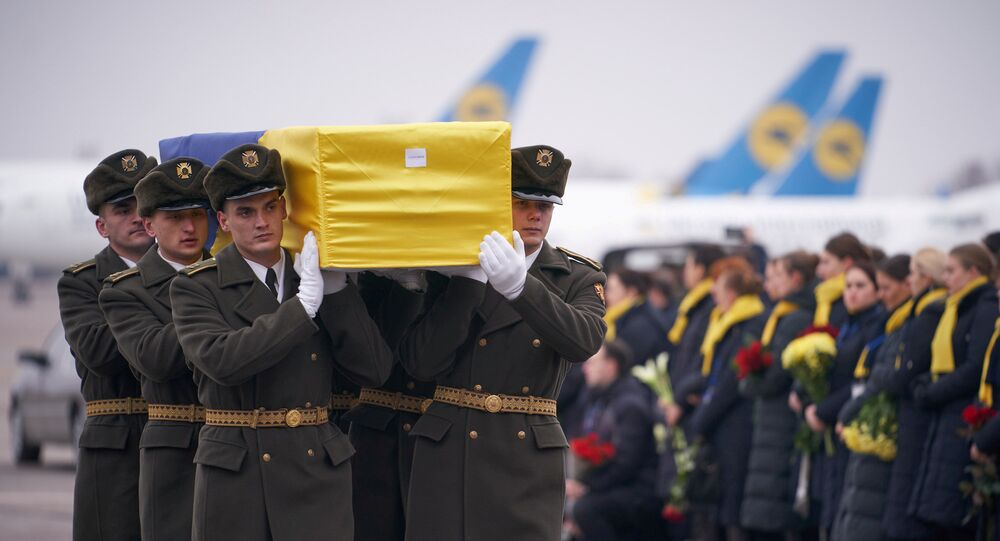 Soldiers carry a coffin containing the remains of one of the eleven Ukrainian victims of the Ukraine International Airlines flight 752 plane disaster during a memorial ceremony at the Boryspil International Airport, outside Kiev, Ukraine January 19, 2020