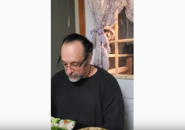 Got Any for Me? Sweet Raccoon Snoops Through Window as Family Eats Dinner