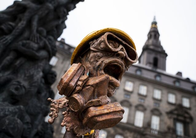 Danish artist Jens Galschiot has erected an 8-meter-high Pillar of Shame in solidarity with the protesters in Hong Kong in front of the Danish Parliament Folketinget at Christiansborg Palace Square in Copenhagen, on January 23, 2020