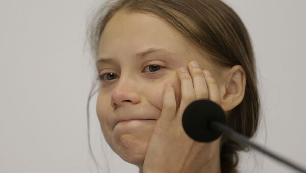 Climate activist Greta Thunberg takes part in a news conference at the COP25 climate summit in Madrid, Spain, Monday, Dec. 9, 2019. Thunberg is in Madrid where a global U.N.-sponsored climate change conference is taking place - Sputnik International