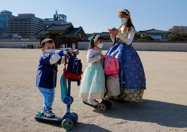 A woman and children wear masks to protect themselves against the new coronavirus in Seoul, South Korea, February 3, 2020.
