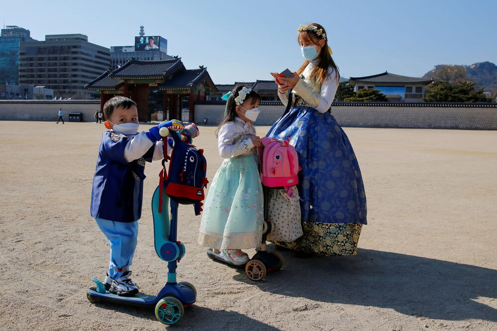 A woman and children wear masks to protect themselves against the new coronavirus in Seoul, South Korea, 3 February 2020.