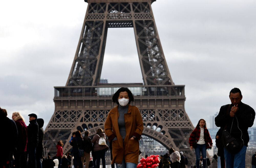 A woman wears a protective mask in light of the coronavirus outbreak in China as she walks at the Trocadero esplanade in front of the Eiffel Tower in Paris, France, 1 February 2020.