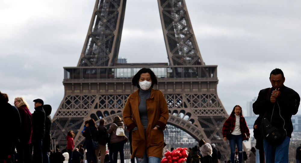 A woman wears a protective mask in light of the coronavirus outbreak in China as she walks at the Trocadero esplanade in front of the Eiffel Tower in Paris, France, February 1, 2020.