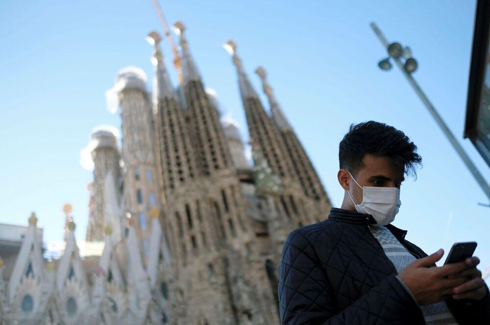A man wears a protective mask in front of the Basilica Sagrada Familia amid the novel coronavirus outbreak, in Barcelona, Spain, 2 February 2020.