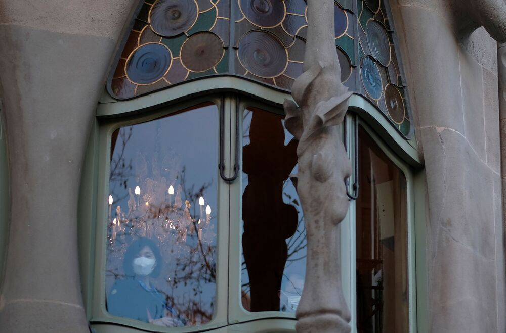 A woman wears a protective mask as she visits the Casa Batllo amid the novel coronavirus outbreak, in Barcelona, Spain, 2 February 2020.