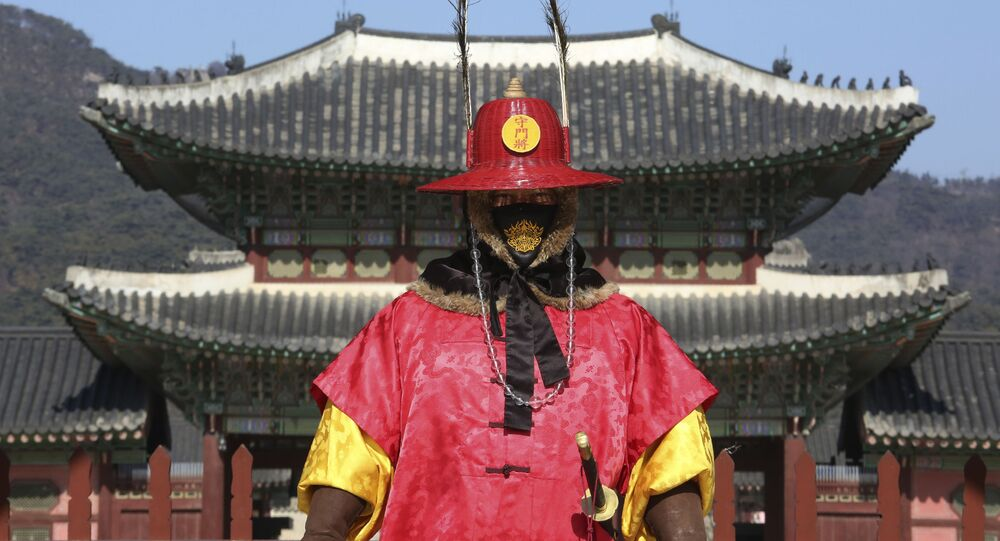 An Imperial guard wearing a face mask stands outside the Gyeongbok Palace, the main royal palace during the Joseon Dynasty in Seoul, South Korea, Monday, Feb. 3, 2020