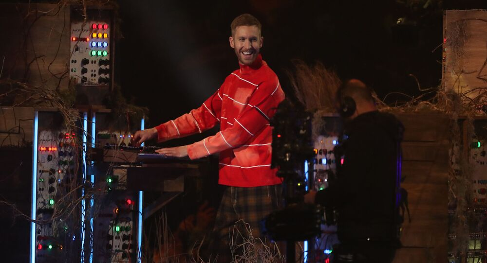 British singer-songwriter Sam Smith (R) performs with British DJ and musician Calvin Harris (L) during the BRIT Awards 2019 ceremony and live show in London on February 20, 2019