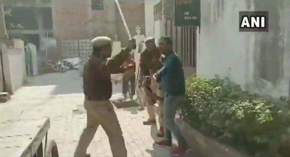 Police resort to lathi-charge & use water cannons on protestors who are demonstrating near Science college in Patna
