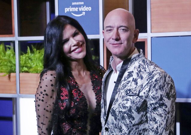 Amazon CEO Jeff Bezos, right and his girlfriend Lauren Sanchez poses for photographs during a blue carpet event organized by Amazon Prime Video in Mumbai
