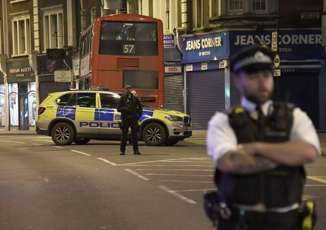 A police officer stands guard near the scene after a stabbing incident in Streatham London, England, Sunday, Feb. 2, 2020